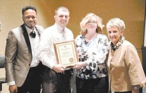 Whitesburg ARH Licensed Practical Nurse Andrew Fugate (second from left) was named the 2017 CARES Award Winner. Fugate received a plaque from Dena Sparkman, Whitesburg ARH Community CEO. Also in the photo are Christopher Johnson and Sonya Bergman, ARH Human Resources.
