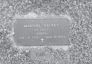 The information on the headstone at Marshel Tacket's grave includes his service with the U.S. Navy in Korea.