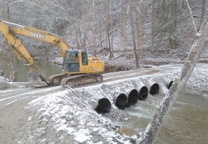 A LOW WATER BRIDGE across Rockhouse Creek will continue to carry resident of Perkins Branch in and out of their homes for now.