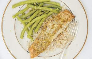 This photo shows mustard and dill crusted salmon. (AP photo)
