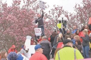 """Letcher Elementary School teacher Tyler Watts helped build enthusiasm at Monday's """"We Have Had Enough"""" teachers rally in Frankfort. Watts was one of about 300 Letcher County educators who traveled to the state capitol to protest pension reform and to show support for better funding for education. (Photo by Chris Anderson)"""