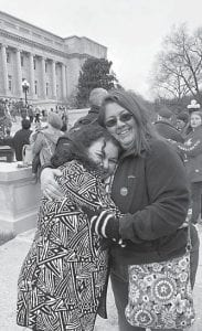 State Rep. Angie Hatton hugs one of Jeanette Tacket's favorite co-workers at Martha Jane Potter Elementary School, Vickie Wampler.