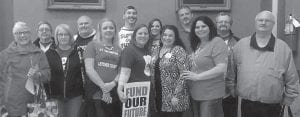 Marchers protesting pension bill are pictured with State Rep. Angie Hatton.