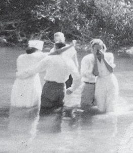 Margaret Combs and her parents are pictured at her baptism.