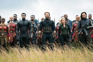 """This image released by Marvel Studios shows, front row from left, Danai Gurira, Chadwick Boseman, Chris Evans, Scarlet Johansson and Sebastian Stan in a scene from """"Avengers: Infinity War,"""" premiering this week. (Chuck Zlotnick/Marvel Studios via AP)"""
