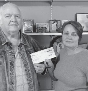 Eolia Christian Community Outreach received a donation of $6,000 for its food pantry from the EQT Foundation. The organization expressed thanks to the foundation for the donation and said how much it helps the food pantry. Pictured are President of the Board Kester Holcomb and Director Amy Gross after receiving the donation.