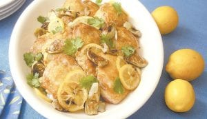 This photo shows baked chicken thighs with preserved lemons and artichoke hearts. (AP Photo)