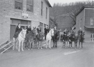 This photo shows eight women in Hindman who worked as Pack Horse Librarians in Knott County. A Pack Horse Library was established in Letcher County, at Whitco, in May 1938. Eleven women were hired here to deliver books by horseback. (Photo courtesy of the University of Kentucky Digital Library's Goodman-Paxton Collection)
