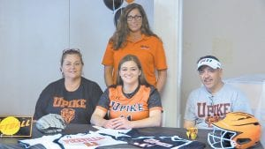 TOGETHER AGAIN — Recent University of Kentucky graduate Mercedes Boggs is returning to college as a graduate student next year to play softball at the University of Pikeville, where her former coach at Jenkins High School, April Charles is an assistant. Boggs (seated, center) signed with UPike at McRoberts Sunday as Charles (standing) and Boggs's parents, Machelle and Kent Boggs, looked on. See story on Page 11.