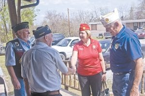 AMERICAN LEGION NATIONAL COMMANDER Denise Rohan shakes hands with Commander Jack Holbrook of the Douglas Day Post 152 on Pine Mountain as Otis Hall, a member of Post 104 in Neon (left) and Department of Kentucky Commander Bill Stewart look on. Rohan is the first woman to be elected National Commander of the American Legion, and the first national commander to visit the post at Whitesburg. (Photo by Sam Adams)