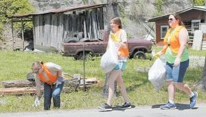 JROTC Cadets Jessika Moushon, Madison Adams and Courtney Browning picked up trash on Cowan.