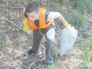 Cadet James Stidham cleared the ditches on Cowan of trash.