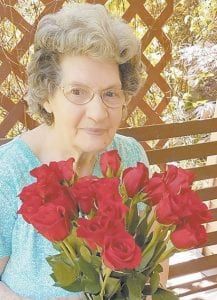 Dorothy Pennington Tacket holds her Mother's Day roses from her son, Albert Tacket, and his wife, Tonya.