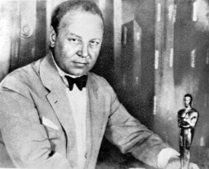 """This 1928 picture shows German actor Emil Jannings with the first Oscar during the Academy Award presented for his 1927 film """"The Way of All Flesh."""" (AP Photo)"""