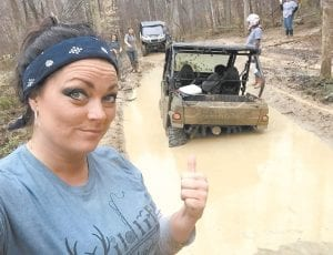 THUMBING A RIDE – Bridgette Holbrook was in a little over her knees on a four-wheeler run. (Photo courtesy Wildlife Women)