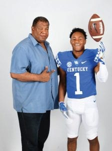 Wandale Robinson, with UK recruiting coordinator Vince Marrow, has 18 scholarship offers but plans to make a college choice before Western Hills' season starts in mid-August. (Twitter Photo)