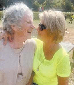 Oma Hatton is hugged by her baby sister, Judy Greene.