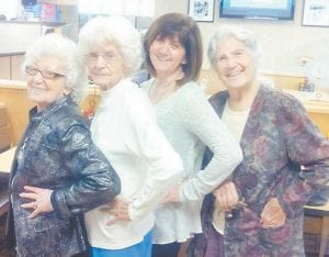 Standing together are four of the Howard sisters, (left to right) Kathleen Brock, Louise Shepherd, Jo Anne Brown, and Oma Hatton.