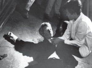 RFK GUNNED DOWN 50 YEARS AGO — Less than four months after his historic visit to Letcher County and elsewhere in Appalachia, Senator Robert F. Kennedy was shot by Sirhan Sirhan while campaigning in Los Angeles. In this June 5, 1968 photo, Sen. Kennedy lies on the floor at the Ambassador Hotel in Los Angeles waiting for the arrival of medical aid moments after he was shot. Assisting Kennedy was hotel busboy Juan Romero, whose hand Kennedy was shaking when the shots were fired. Kennedy died the next day. (AP Photo/Los Angeles Times)