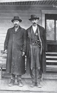 In the Common Heritage Exhibit at Appalshop is this photograph of two men.