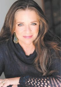 TO PERFORM — Country musician Carlene Carter, the daughter of June Carter Cash and country star Carl Smith, and stepdaughter of Johnny Cash, will perform at River Park in Whitesburg this Saturday night at 8:30 p.m. There is no charge for admission. A fireworks show will follow.