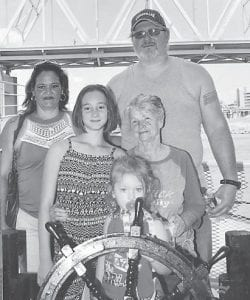 Mart and Sue Hall, Brooke Brown, Izzy Hall, and Rose Ballard take a cruise on B& B Riverboat.