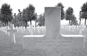 This recent photo shows an epitaph on the back of a headstone at the World War I Aisne Marne cemetery in Belleau, France. The World War I battle of Belleau Wood in northern France pitted untested U.S. forces against the more-experienced Germans, who were making a push toward Paris. It became a defining moment, proving the Americans' military mettle and helping turn the tide of the war. (AP Photo/Virginia Mayo)