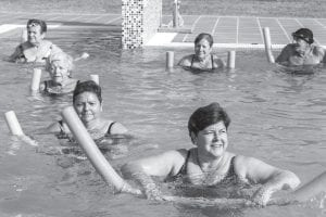 """Much like the water aerobics class seen here, """"aqua yoga"""" is practiced in the shallow end of the pool, so even if you can't swim you can still exercise safely. The classes are held in Jenkins on Saturdays."""