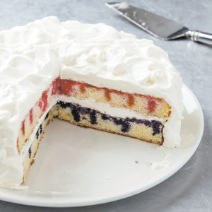 """This photo provided by America's Test Kitchen shows patriotic poke cake. This recipe appears in the cookbook """"The Perfect Cake."""" (Joe Keller/America's Test Kitchen via AP)"""