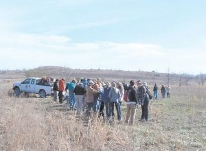NINE YEARS AGO – Volunteers lined up to get tree seedlings and instructions during a planting on Jent Mountain at Carcassonne in 2009. The old strip mine was barren then, with only some lespedeza grasses and scrub brush. (All photos by Sam Adams)