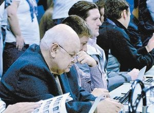 Oscar Combs, left, has covered UK sports since founding the Cats' Pause in 1976. (Gary Moyers Photo)