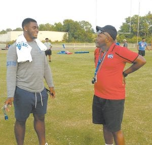 Kentucky defensive lineman Josh Paschal talked with Mercer County athletics director Donald Smith during a visit to the Mercer Football Youth Clinic last week. (Larry Vaught Photo)