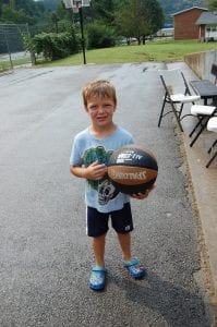 Jackson McCall posed with a new basketball he was given by members of the Whitesburg Rotary Club.