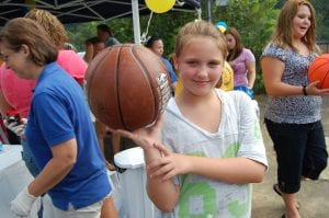 Kahlan Adams posed for a photograph with a new basketball she received from members of the Whitesburg Rotary Club.