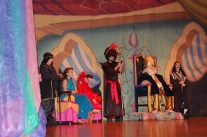 Pictured in the Sultan's palace are from left Aaron Creech (guard), Kendra Lewis (Jasmine), Jack Madden (Lago), Matt Fields (Jafar), Noah Blair (Sultan) and Allison Baker (guard).