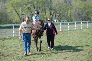 Mark Howard rode a horse. Also pictured is Teresa Pigman, an instructional assistant at MJP.