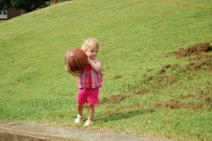 Morgan Hurst played with a new basketball given to her by members of the Whitesburg Rotary Club.