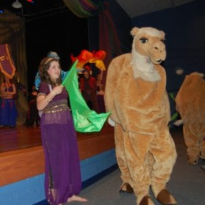 Holly Thomas is pictured beside a camel.