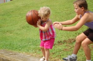 Sisters Morgan and Madison Hurst played basketball August 10 at the Whitesburg Housing Authority.