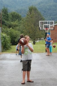Kahlan Adams played basketball at the Whitesburg Housing Authority August 10.