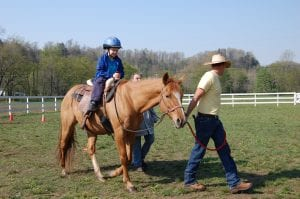 Matthew Wilder rode a horse. He is pictured with Drew Baldwin and Diane Wiseman, an istructional assistant at MJP.