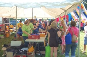 Volunteers handed out free school supplies at Letcher County Kids' Day Back to School Bash at River Park in Whitesburg on July 29.
