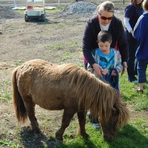 Mark Howard and Teresa Pigman, an instructional assistant at MJP, looked at a miniature pony.
