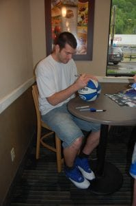 Josh Harrellson autographed a basketball.