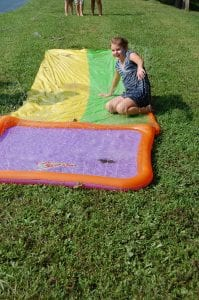 Alexis Mullins, 9, took a turn getting splashed by a water sprinkler at the Letcher County Kids' Day Back to School Bash at River Park in Whitesburg on July 29. She is in the fourth grade at Beckham Bates Elementary School. Alexis's parents are Tabitha Logan and Harlan Mullins of Colson.