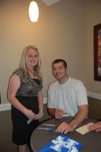 Maegyn Bates of Whitesburg posed for a photograph with Josh Harrellson.