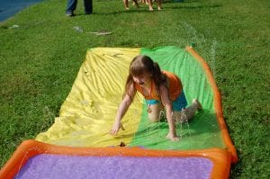 Emmaleigh Caudill, 5, cooled off on a hot summer day by playing on a water tarp at Letcher County Kids' Day Back to School Bash at River Park in Whitesburg on July 29. Emmaleigh's mother is Crystal Caudill of Smoot Creek. Emmaleigh is in kindergarten at Cowan Elementary School.