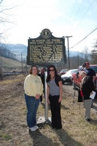 Misty Delph and Bridgette Holbrook posed for a photo on March 9 in front of an historic marker which was erected on Tuesday in honor of those who died in the Scotia mine disaster. Holbrook was three years old at the time of the explosion and her mother, Madonna, was pregnant with Delph.