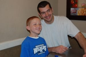 Josh Harrellson told Landon Tolliver, 7, of Little Cowan, to stand up before he posed for a photo.