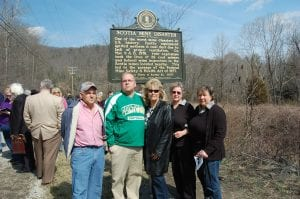 Family members of Dennis C. Boggs posed for a photograph in front of an historical marker honoring those who died in the Scotia mine disaster. Boggs died in the first explosion on March 9, 1976. Pictured from left are Dennis C. Boggs's brother Everett Boggs, his son Dennis Boggs, his wife Jennifer Boggs Fuller, his sister Iva Stidham and his sister Kaye Cantrell.